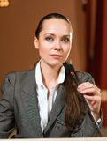 Portrait of a business woman with microphone Stock Photos