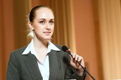 Portrait of a business woman with microphone Stock Photography