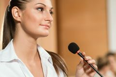 Portrait of a business woman with microphone Royalty Free Stock Photo