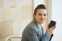 Portrait of business woman with mobile phone Royalty Free Stock Photo