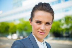 Portrait of business woman in modern office district Stock Image