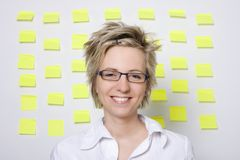 Portrait of business woman with note papers Royalty Free Stock Photo