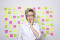 Portrait of business woman with note papers Stock Photo