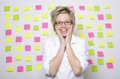 Portrait of business woman with note papers. On white background Royalty Free Stock Image