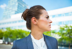 Portrait of business woman in office district looking aside Stock Image