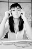 Portrait of business woman in office with strong headache black and white royalty free stock image