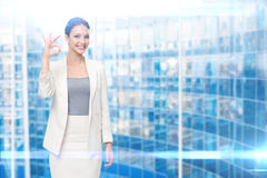 Portrait of business woman ok gesturing Royalty Free Stock Images