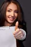 Portrait of  business woman with paper folder,smiles. Studio shot of an attractive young businesswoman Royalty Free Stock Image