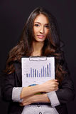 Portrait of  business woman with paper folder. Portrait of a smiling businesswoman holding paperwork isolated Stock Photos