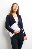 Portrait of business woman with papers over white Stock Photos