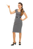 Portrait of business woman pointing in corner Stock Photography