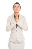 Portrait of business woman praying Stock Photo