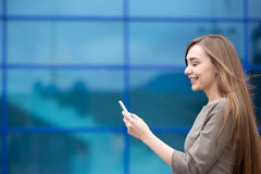 Portrait of business woman sending phone message. Copy space Stock Images