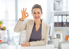 Portrait of business woman showing ok gesture Stock Image
