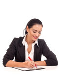 Portrait of business woman signing documents Stock Photos