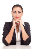 Portrait of business woman sitting on her desk Stock Photography