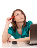 Portrait of business woman sitting on her desk Stock Photo