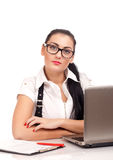 Portrait of business woman sitting on her desk Royalty Free Stock Photography
