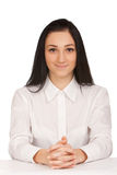 Portrait of business woman sitting on her desk Stock Photos