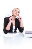 Portrait of business woman sitting on her desk. Royalty Free Stock Images