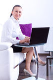 Portrait of business woman sitting with laptop Stock Photos