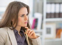 Portrait of business woman sitting in office. Portrait of concerned business woman sitting in office Stock Image