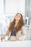 Portrait of business woman sitting in office Stock Image