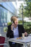 Portrait of a business woman sitting relaxed at outdoor cafe royalty free stock photo
