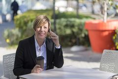 Portrait of a business woman sitting relaxed at outdoor cafe stock photography