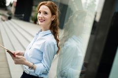 Portrait of business woman smiling outdoor Royalty Free Stock Photography