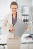 Portrait of business woman standing with folder Royalty Free Stock Images