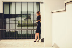 Portrait of a business woman standing near office buildings Royalty Free Stock Photos