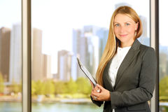 Portrait of business woman standing  near window Stock Images