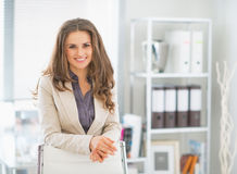 Portrait of business woman standing in office Stock Images