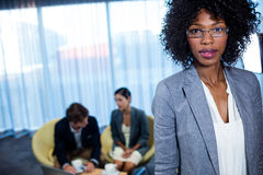 Portrait of business woman standing Stock Photos