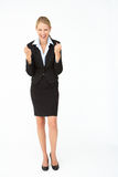 Portrait of business woman in suit. Smiling at camera Stock Photo