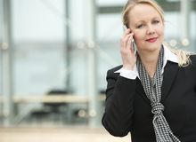 Portrait of a business woman talking on cellphone outdoors. Close up portrait of a business woman talking on cellphone outdoors Royalty Free Stock Photo