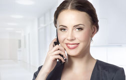 Portrait of business woman talking on the phone Stock Image