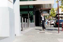 Portrait of business woman walking outdoor Stock Photo