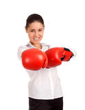 Portrait of business woman wearing boxing gloves Royalty Free Stock Photography