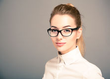 Portrait of Business Woman Wearing Glasses. Portrait of Beautiful Business Woman Wearing White Shirt and Glasses Stock Photos