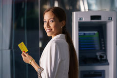 Portrait business woman withdraw cash machine card Royalty Free Stock Photos