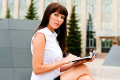Portrait of a business woman at work. Young business woman working with netbook Royalty Free Stock Image
