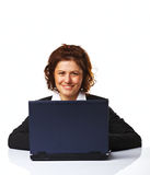 Portrait of a business woman working on a laptop. Over white background Royalty Free Stock Photo