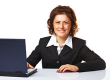 Portrait of a business woman working on a laptop. Over white background Stock Image