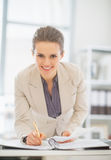 Portrait of business woman working in office Stock Photo