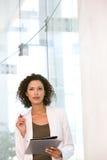 Portrait of business woman writing Stock Photo