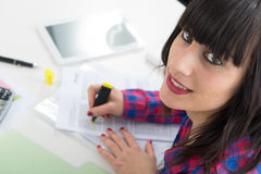 Portrait of a business woman writing in a notebook Stock Photo