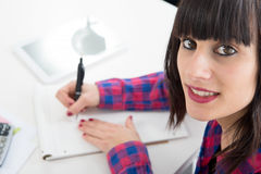 Portrait of a business woman writing in a notebook Stock Photography