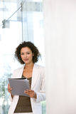 Portrait of business woman writing on notepad Stock Photography
